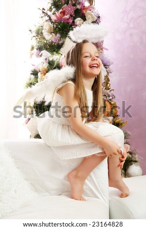 Six years old little blonde girl acting as Christmas angel. - stock photo