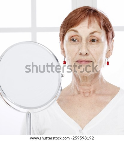 Sixty years old woman and care - stock photo