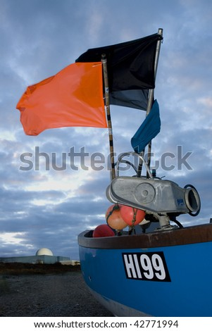 Sizewell B nuclear power station with a fishing boat in the foreground - stock photo