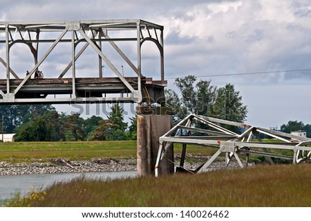 SKAGIT COUNTY, WA - MAY 23:  Steel bridge collapses due to a truck hitting a part of the bridge.  Main interstate I-5 impacts region.  May 23, 2013 in Skagit County, Wa - stock photo