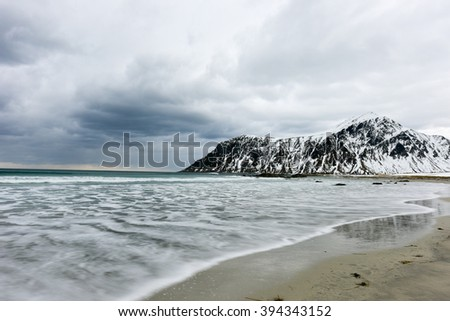 Skagsanden Beach in the Lofoten Islands, Norway in the winter on a cloudy day.