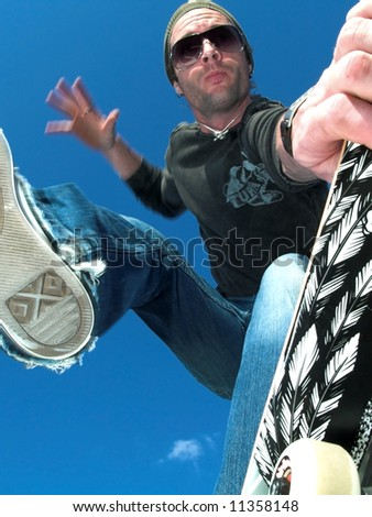Skate boarder in motion  (Action shoot has blur to it) - stock photo