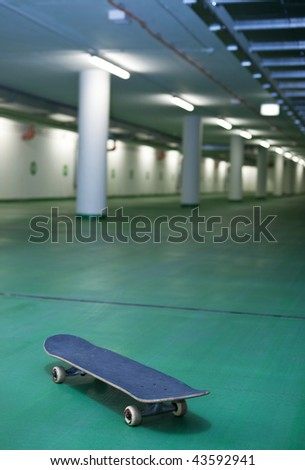 skateboard in an underground parking - perfect place for a ride - stock photo