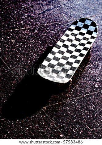 Skateboard placed on tile on outside - stock photo