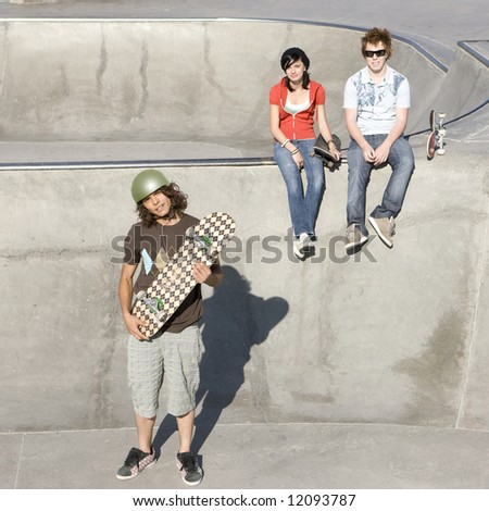 Skateboarder and friends - stock photo