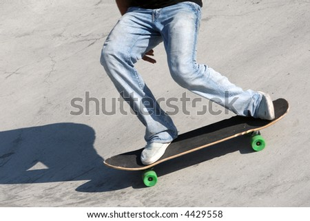 Skateboarder at a skate park - stock photo