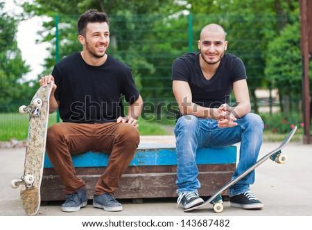 Skateboarder friends portrait at skatepark. - stock photo
