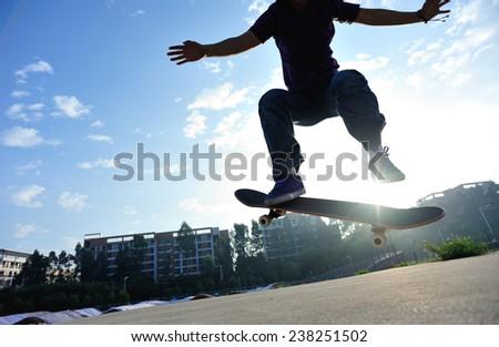 skateboarder skateboarding outdoor - stock photo