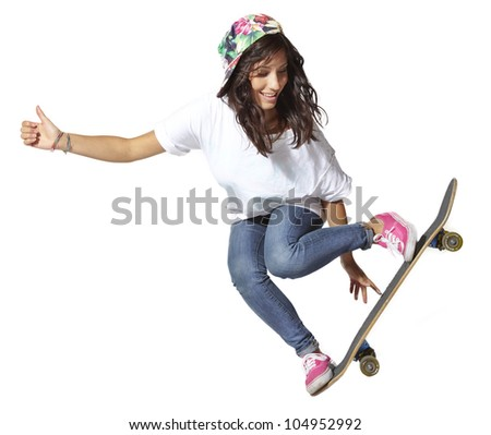 Skateboarder woman jumping isolated on white showing thumbs up - stock photo