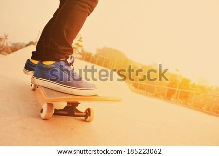 skateboarding at skatepark - stock photo