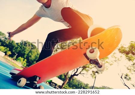 skateboarding woman at skatepark - stock photo