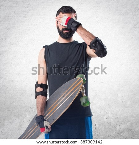 Skater covering his face