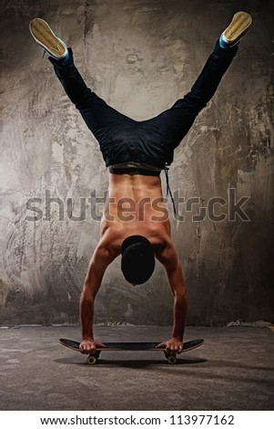 Skater doing a trick - stock photo