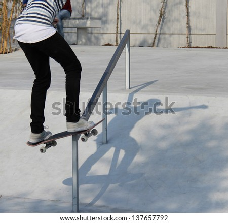 skater on slide - stock photo