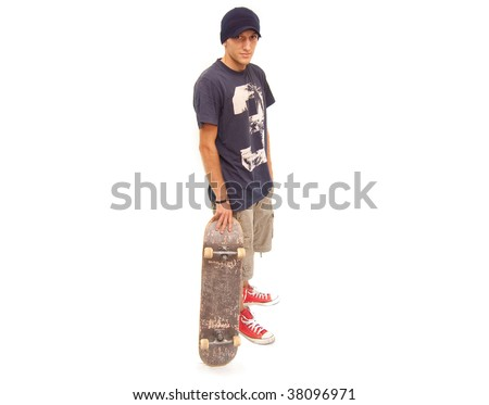 skater posing with a skateboard on white background - stock photo