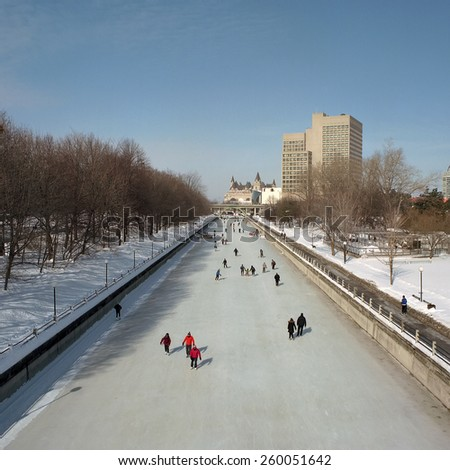 Skating on the Rideau Canal in Ottawa - stock photo