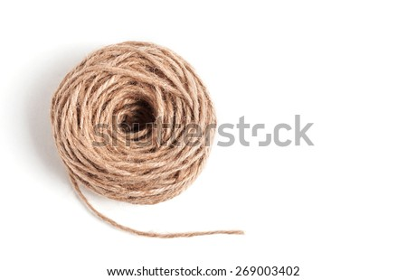 Skein of jute twine on the white background - stock photo