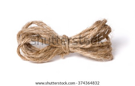 Skein of jute twine on the white background (bow) - stock photo