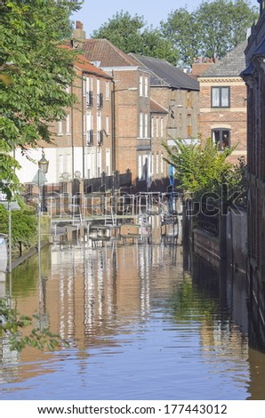 Skeldergate, York. Flooded The River Ouse in York often floods with nearby streets like Skeldergate suffering. This shows a temporary footbridge allowing residents access to their houses. - stock photo