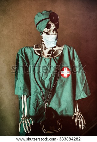 Skeleton Doctor Bag. A skeleton in doctor scrubs, hospital attire, classic accessories and antique doctors bag. Edited with vintage film effects. - stock photo