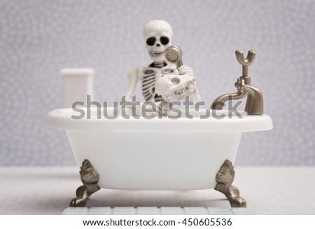 Skeleton dog getting bath - stock photo