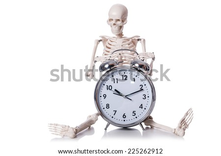 Skeleton with alarm clock on the white - stock photo