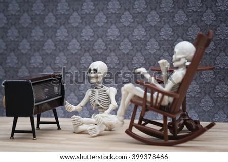 skeletons listening radio - stock photo