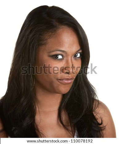 Skeptical African woman with long hair on white background - stock photo