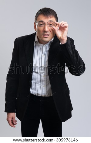 Skeptical businessman looking isolated on gray background
