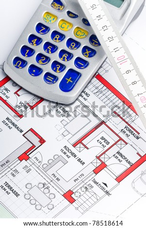 sketch of a houseplan with a calculator and a ruler