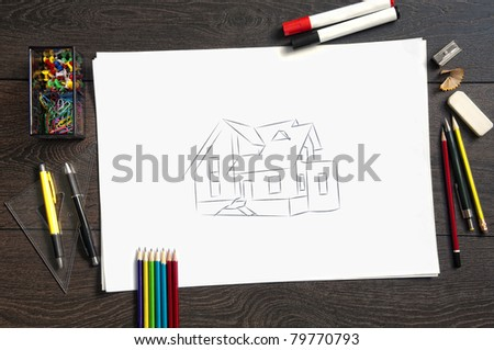 Sketch of housing project on a wooden desk - stock photo