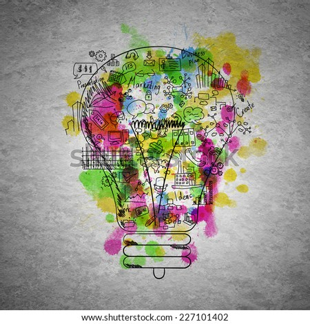 Sketch of light bulb and business ideas on cement wall - stock photo
