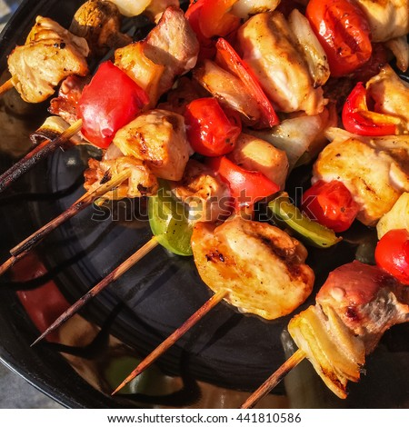 Skewers with grilled meat and vegetables. Outdoor barbecue.