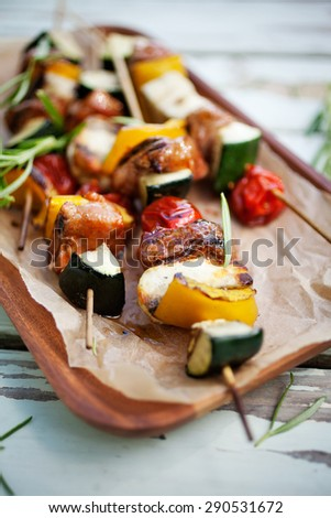 Skewers with halloumi, meat and tomato - stock photo