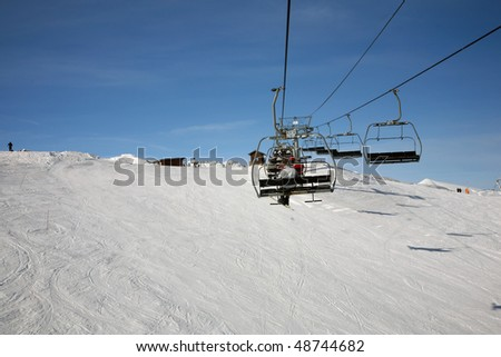 ski chair lift trip in mountains