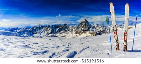 Ski Equipment with panoramic view of Matterhorn on a clear sunny winter day, Zermatt, Switzerland