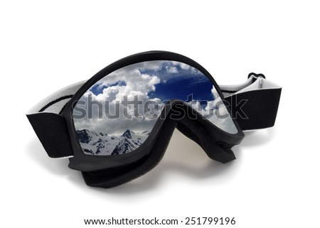 Ski goggles with reflection of cloudy mountains. Isolated on white background - stock photo