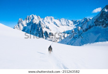 Ski in the blue sky ant mountains background - stock photo
