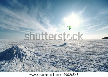 Ski kiting on a frozen lake - stock photo