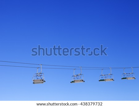 Ski-lift and blue clear sky at sun day - stock photo