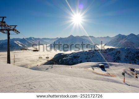 Ski lift and ski slope - stock photo