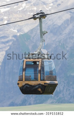 Ski lift cable booth or car, Switzerland in summer - stock photo