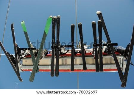 Ski lift carrying skiers. - stock photo