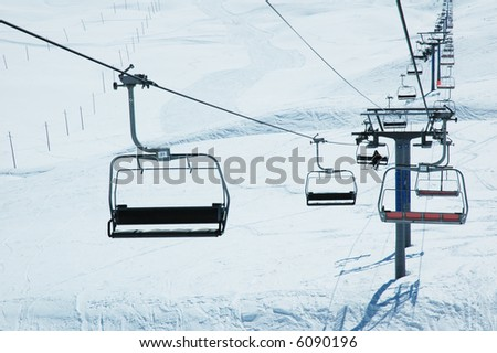 Ski lift chairs on bright winter day - more similar photos in my portfolio