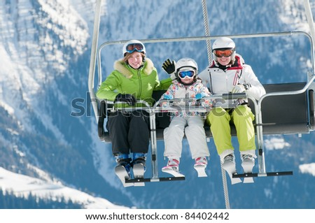 Ski lift - family on ski vacation - stock photo