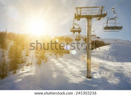 ski-lift in sunshine - stock photo