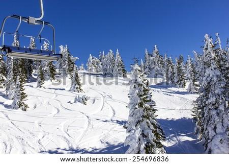 Ski lift in the mountain - stock photo