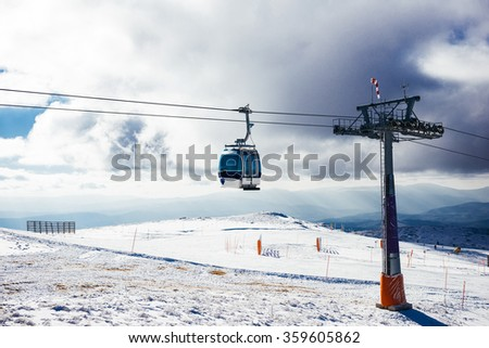 Ski lift on a cloudy winter sky.