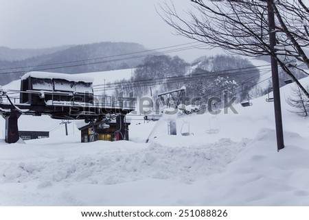 ski lift on snow slopes