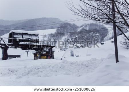 ski lift on snow slopes - stock photo